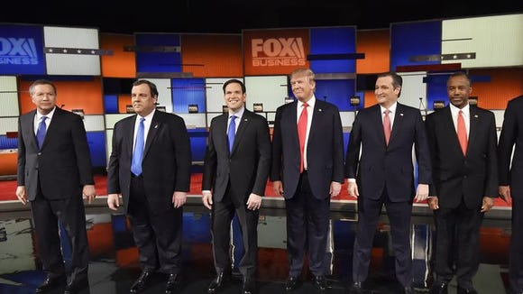 Republican presidential candidates take the stage before the Republican presidential debate. Rainier Ehrhardt, AP