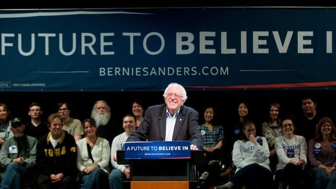Democratic presidential candidate Sen. Bernie Sanders smiles at Muscatine High School in Muscatine, Iowa on Dec. 29, 2015.