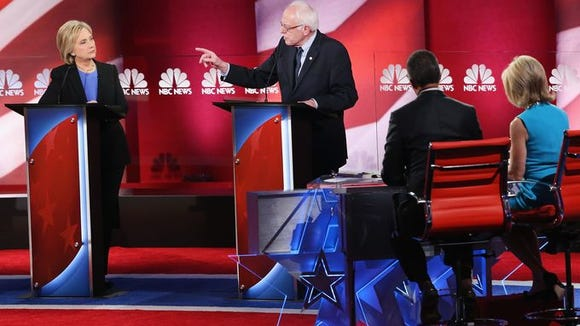 Hillary Clinton and Sen. Bernie Sanders, I-Vt., field questions from moderators Lester Holt and Andrea Mitchell during the Democratic presidential debate. Andrew Burton, Getty Images