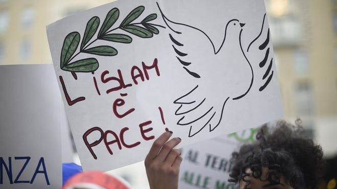 "A poster reading ""Islam Is Peace"" during a demonstration of Muslims to speak out against terrorism on Nov. 21, 2015, in Milan."