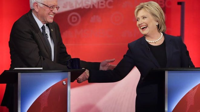 Sen. Bernie Sanders and Hillary Clinton shake hands during a Democratic presidential primary debate.