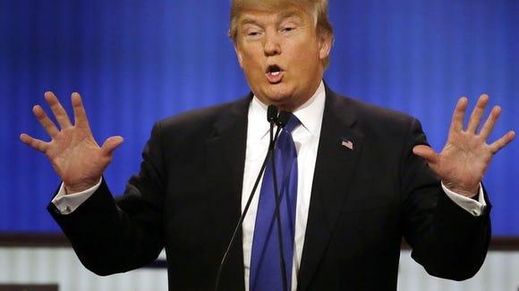 Donald Trump speaks during the Republican presidential debate. Carlos Osorio, AP
