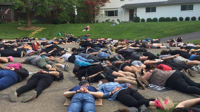 Protesters laid down for 8 minutes and 46 seconds in front of Mayor Andrew Ginther's home.