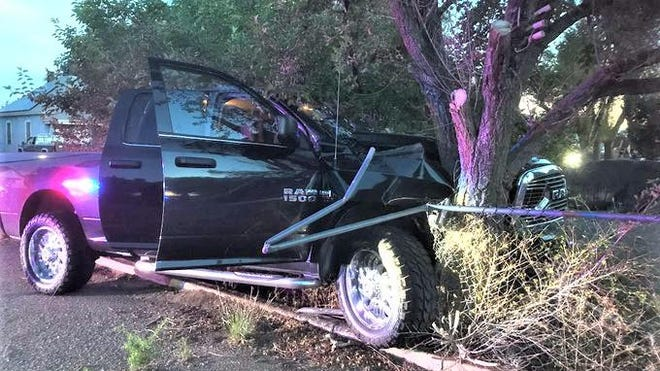 After carjacking this vehicle, two juveniles crashed it into a fence and tree at Routt and  Emerson avenues, before fleeing early Saturday, according to the Pueblo Police Department.
