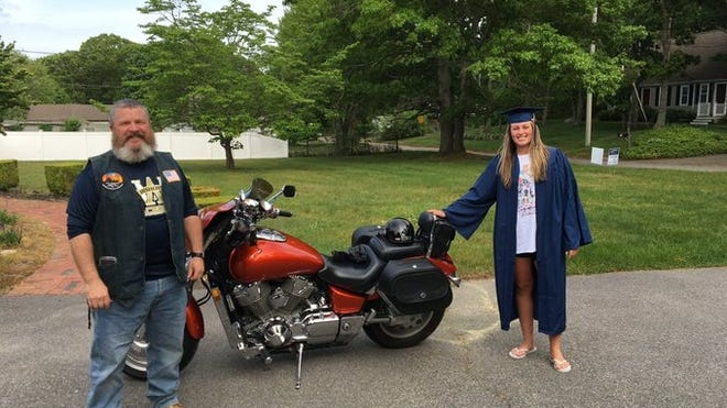 Archbishop Williams athletic director Gordon McClay delivers a care package to graduated senior Meg Marcel, who worked as an intern in the athletic office.