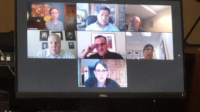Seven members of the City of Topeka's governing body, which consists of the mayor and city council, took part in their meeting Tuesday evening using Zoom.