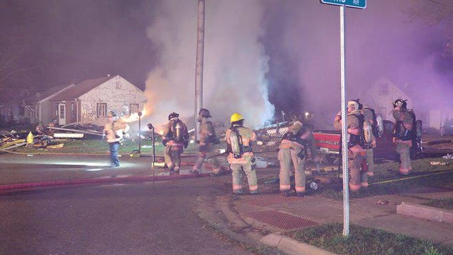 Firefighters work the scene of a home explosion Tuesday, Sept. 29, 2020, at Lapey Street and Willis Avenue in Rockford. Two people were taken to the hospital with life-threatening injuries.
