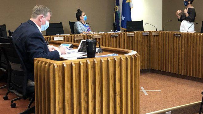 Topeka City Council members, from left, Spencer Duncan, Christina Valdivia-Alcala and Karen Hiller awaited the beginning of their meeting Tuesday.