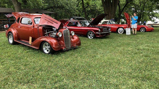 This 1936 Chevrolet Coupe, 1966 Ford Mustang, 1957 Ford Thunderbird and 2002 Porsche Boxster belong to members of the family of Ellis Needham, Jr., 75, of Wakarusa, who died last November. They were all on display Saturday at the Spirit of Kansas Car Show at Lake Shawnee.