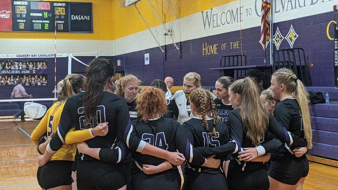Calvary coach Hannah Hunter talks to her team after the loss to Hebron Christian Wednesday night.