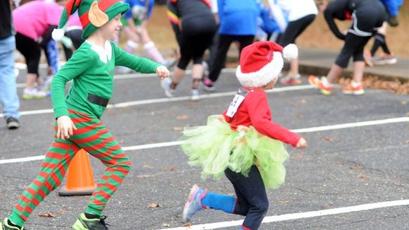 Runners take part in the Asheville Jingle Bell 5K Dec. 6. The inaugural Jones Family Scholarship Reindeer Run/Walk 5K will start at 9 a.m. Dec. 24 at North Henderson High School.
