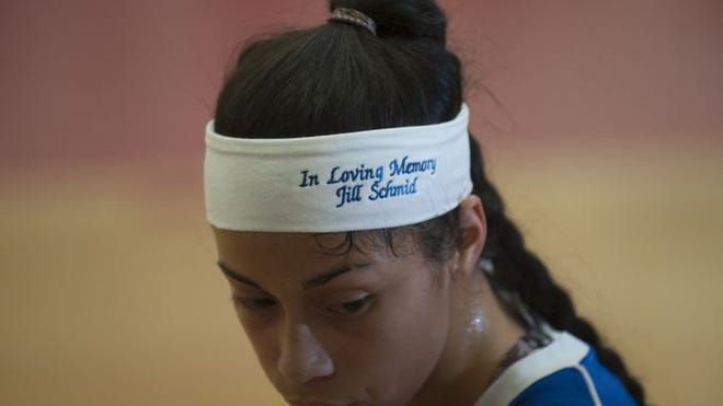 Sterling's Leila Zapata sports the team headband the girls are wearing this season in honor of Jill Schmid, the late mother of Sterling coach Katie McDonald, who passed away in May.