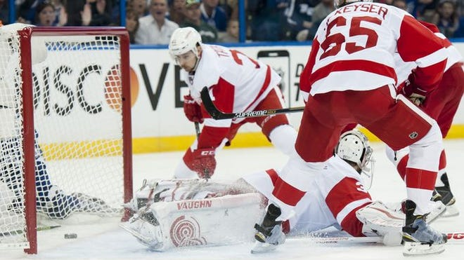 A second-period goal by Tampa Bay center Alex Killorn slips past Detroit goalie Petr Mrazek and Tomas Tatar.
