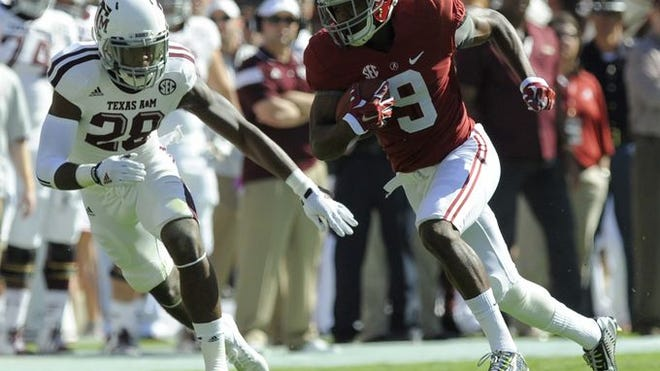 Alabama wide receiver Amari Cooper gets by Texas A&M defensive back Victor Davis at Bryant-Denny Stadium in Tuscaloosa on Saturday.