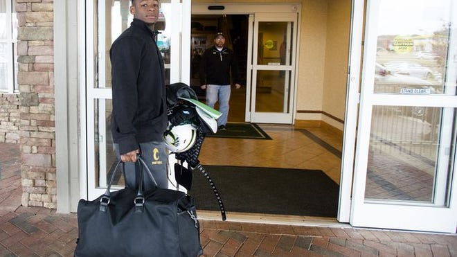 G.W. Carver safety Melvin Tyus goes to check in a hotel on Monday for the Alabama-Mississippi All Star Game.
