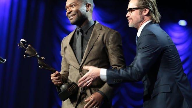 Brad Pitt presents David Oyelowo with Breakthrough Performance Award at Palm Springs International Film Festival.