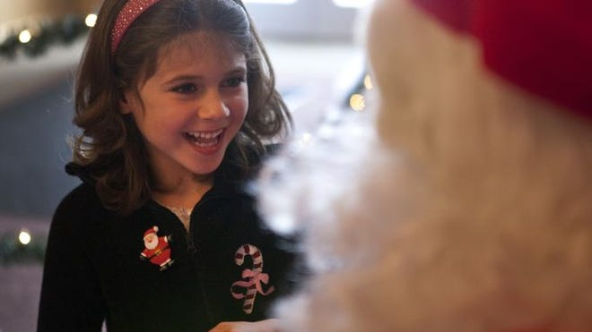 Gabriella Maccarone of Hilton tells Santa Claus what she wants for Christmas at Springdale Farm in Spencerport. LAUREN PETRACCA/@LaurenPetracca/, STAFF PHOTOGRPAHER