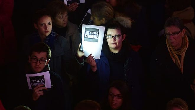 "People hold signs reading ""I am Charlie"" — a reference to the magazine Charlie Hebdo, which was targeted by terrorists — during a demonstration Wednesday in Toulouse, France."