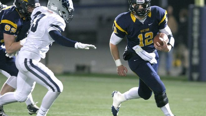Mike Wagner, carrying the ball here, is the 2014 All-Greater Rochester Player of the Year.