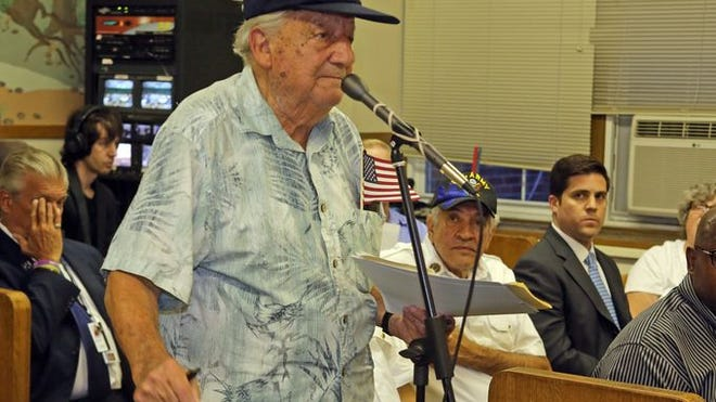 """Armando """"Chick"""" Gallela, a World War II veteran, speaks in support of former Marine Corps Capt. Greg Lobato on Tuesday at a Sleepy Hollow village board meeting."""