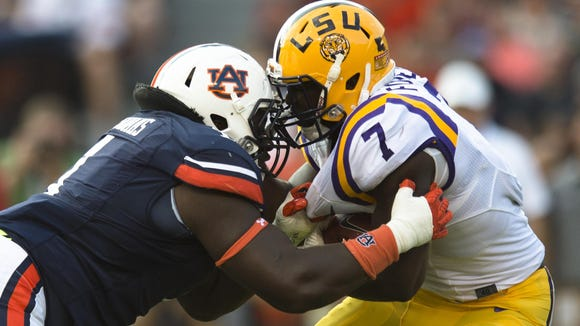 Auburn defensive tackle Montravius Adams (1) tackles LSU running back Leonard Fournette (7) for a loss during NCAA football game between Auburn and LSU Saturday, Sept. 24, 2016, at Jordan Hare Stadium in Auburn, Ala.