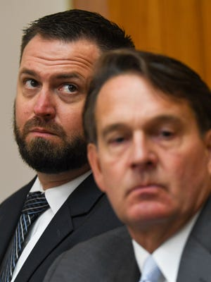 Joseph Jess Fleming, 37, left, of Pendleton sits with attorney Beattie Ashmore of Greenville during an appearance for a preliminary hearing in the Anderson County Courthouse on Friday. The hearing was delayed in the case with Fleming, an Army Corps of Engineers employee has been charged with reckless homicide by boat. The case is related to the death of Devin Hodges, an Anderson County Sheriff's deputy who was mortally wounded June 1 during a training exercise on Lake Hartwell.
