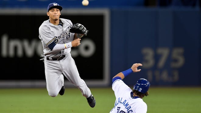 Orlando Arcia throws after getting the force out on Toronto Blue Jay Jarrod Saltalamacchia.
