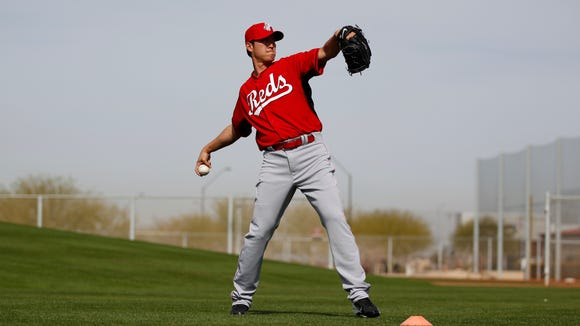 The Reds' Chien-Ming Wang throws after practice during spring training in February.