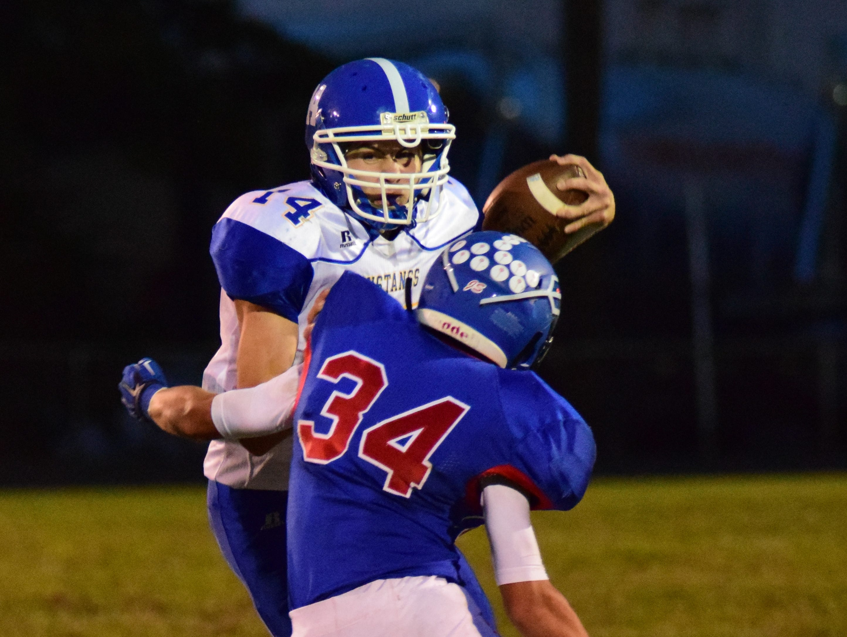 Reading's Aiden Ashbrock (34) wraps up Madeira's Kyle Johnson before he can gain first down yards.