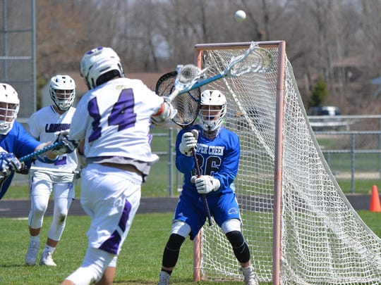 Lakeview's Canyon Upston shoots on Harper Creek goalie Storm Rowles during the All-City tourney on Saturday.