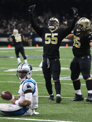 Jan 7, 2018; New Orleans, LA, USA; New Orleans Saints linebacker Jonathan Freeny (55) reacts with defensive tackle Tyeler Davison (95) after tackling Carolina Panthers quarterback Cam Newton (1) during the third quarter in the NFC Wild Card playoff football game at Mercedes-Benz Superdome. Mandatory Credit: Chuck Cook-USA TODAY Sports