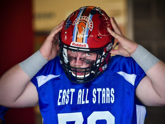 Garrett Vanover (Kings High School) tightens his chin strap before taking the field Thursday, June 7th at the SWOFCA East/West All-Star Game