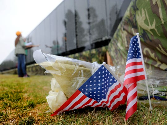 "Flowers with flags are placed at ""The Moving Wall"" at the Ventura County Government Center. The wall is a half-size replica of the Vietnam Veterans Memorial in Washington, D.C."