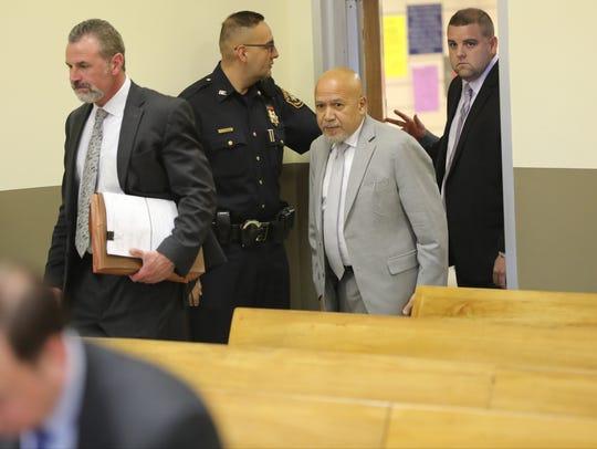 Paterson Mayor Joey Torres, in gray suit, enters Judge