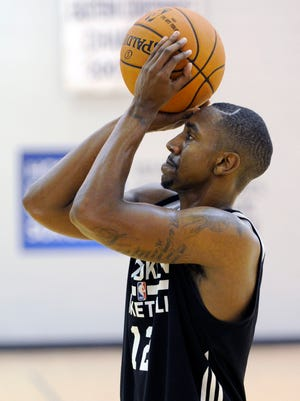 Brooklyn Nets' Marquis Teague practices his foul shot after an NBA basketball practice Saturday, Sept. 27, 2014, in East Rutherford, N.J. (AP Photo/Bill Kostroun)