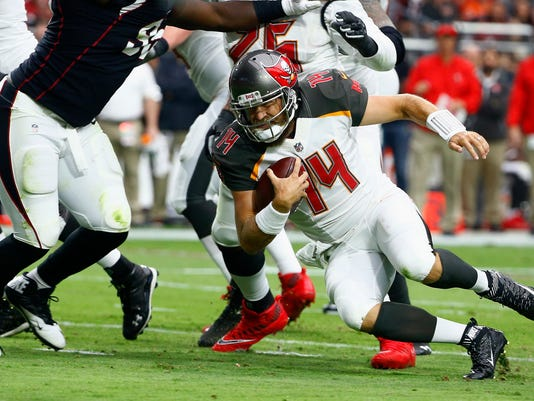 Tampa Bay Buccaneers quarterback Ryan Fitzpatrick (14) dives for yardage against the Arizona Cardinals during the first half of an NFL football game, Sunday, Oct. 15, 2017, in Glendale, Ariz. (AP Photo/Ralph Freso)