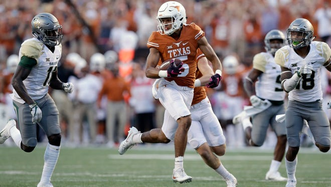Texas wide receiver Lorenzo Joe (5) runs on a 61-yard pass play to set up a touchdown during the second half against Baylor, Saturday, Oct. 29, 2016, in Austin. Texas won 35-34.