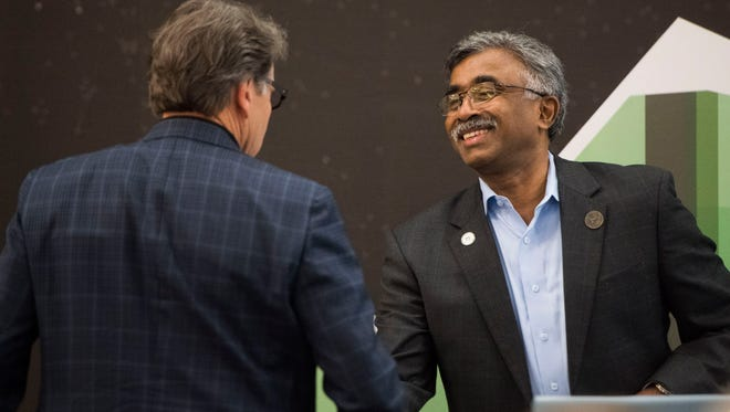 From left Secretary of the U.S. Department of Energy Rick Perry, Chairman shakes Director of ORNL Thomas Zacharia's hand at the launch of the Summit Supercomputer, the worlds most powerful and smartest scientific supercomputer, at Oak Ridge National Laboratory Friday, June 8, 2018.