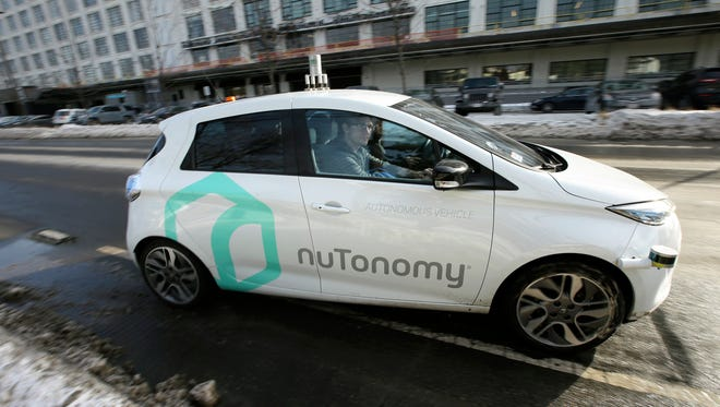In this Tuesday, Jan. 10, 2017, photo, an autonomous vehicle is driven by an engineer on a street through an industrial park, in Boston. Researchers at Massachusetts Institute of Technology are asking human drivers how they'd handle life-or-death decisions in hopes of creating better algorithms to guide autonomous vehicles.