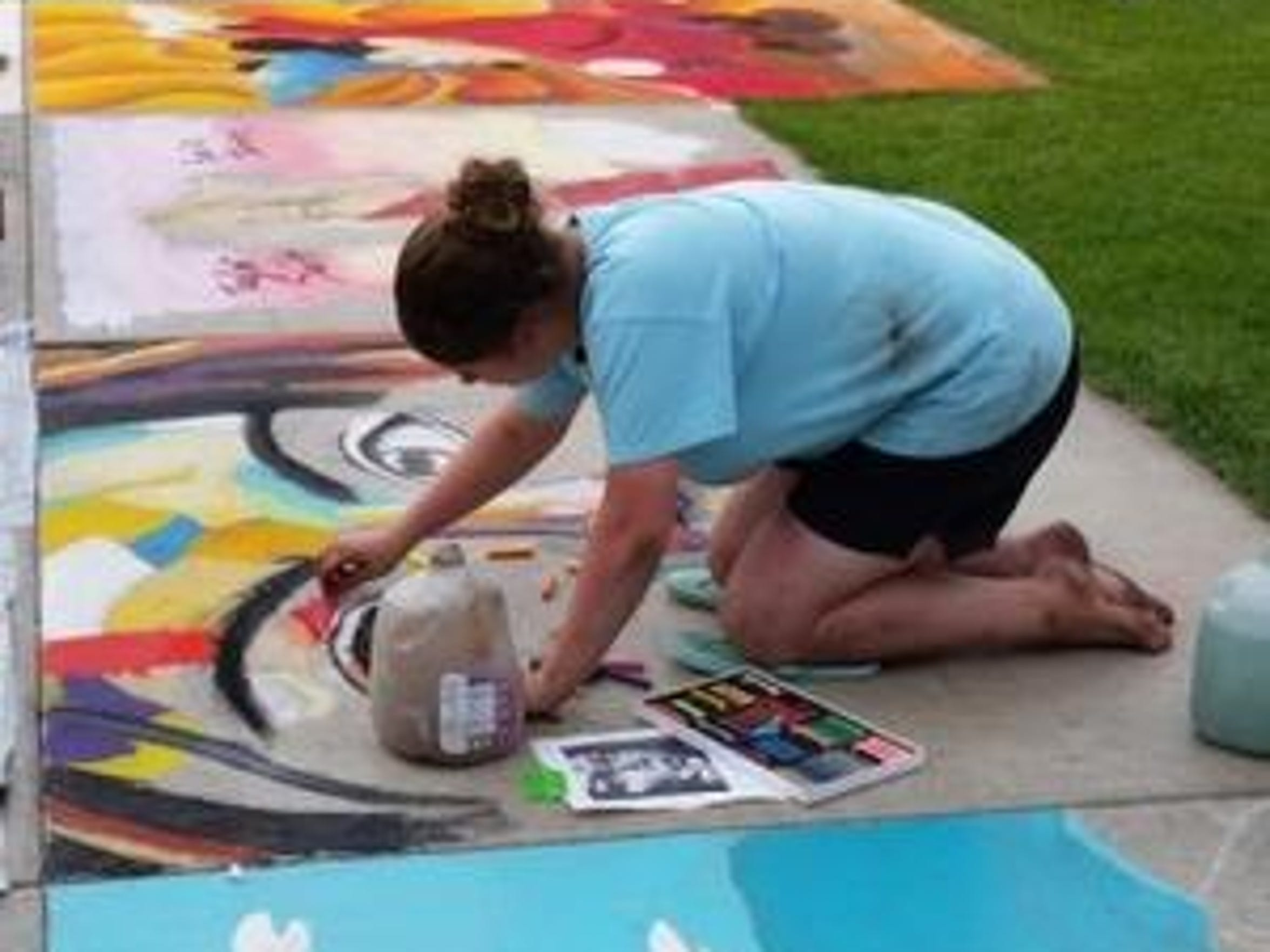 Photo courtesy of Jamie Bootz. Paige Bootz works on a portrait at Chalkfest 2015 in downtown Wausau.