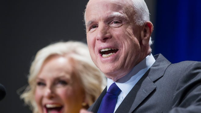 Sen. John McCain, with his wife Cindy, gives a victory speech to his supporters on Tuesday, Nov. 8, 2016.