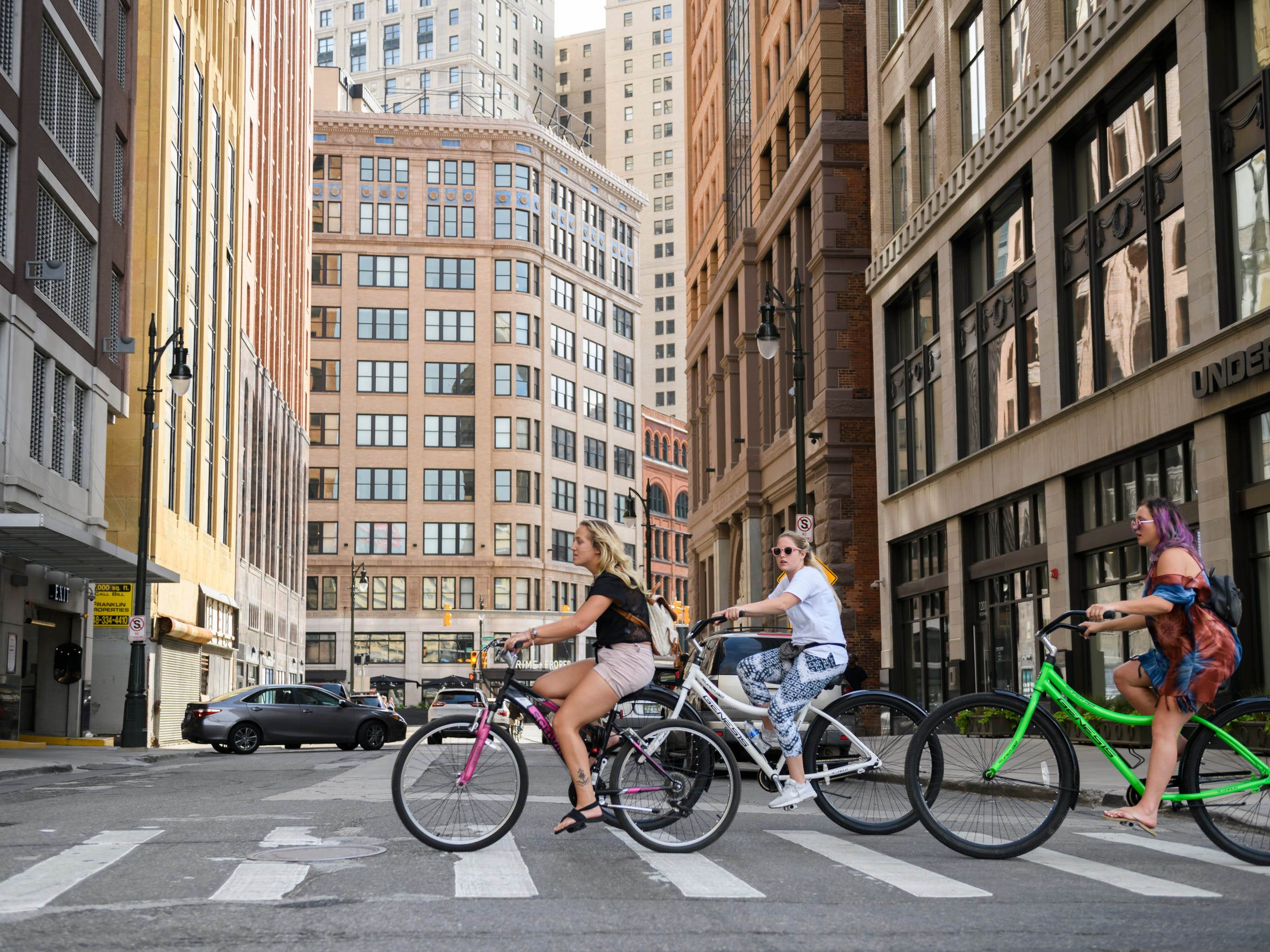 Bicyclists peddle across State Street along Woodward Avenue in downtown Detroit earlier this month.