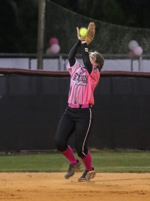 West Florida Tech's Ealon Pyle (31) catches the ball to get Tate's Hayden Lindsay out during the 8th annual Strike Out Cancer charity game at Tate High School Friday night. Over $15,000 was raised with what the two softball teams collected before the game and the donations that were accepted throughout the night.