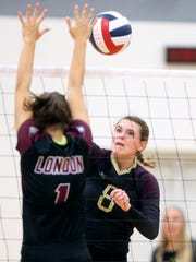 Tuloso-Midway's Katelyn Rozypal hits the ball against London during the CCISD McDonald's SpikeFest Championship game on Saturday, Aug. 12, 2017, at Veterans Memorial High School in Corpus Christi.