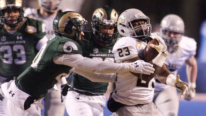 Idaho running back Aaron Duckworth (23) runs the ball past CSU defensive backs Jamal Hicks, left, and Justin Sweet during the Famous Idaho Potato Bowl on Dec. 22, 2016. The Rams finished the season ranked 72, according to USA TODAY Sports.