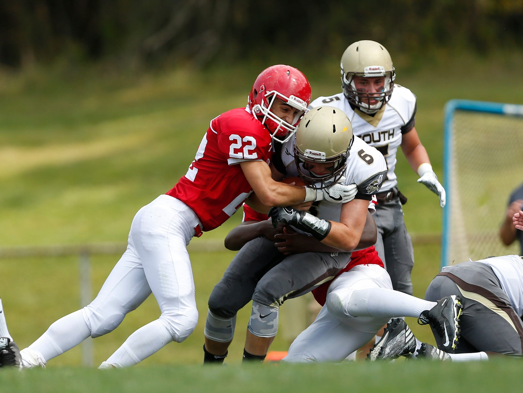 Clarkstown South quarterback Matt Jung (6) is tackled by North Rockland's Damian Colon (22) during football action at North Rockland High School in Thiells on Saturday, September 10, 2016. The second half is postponed due to heat. Clarkstown South is up at the half, 17-0.