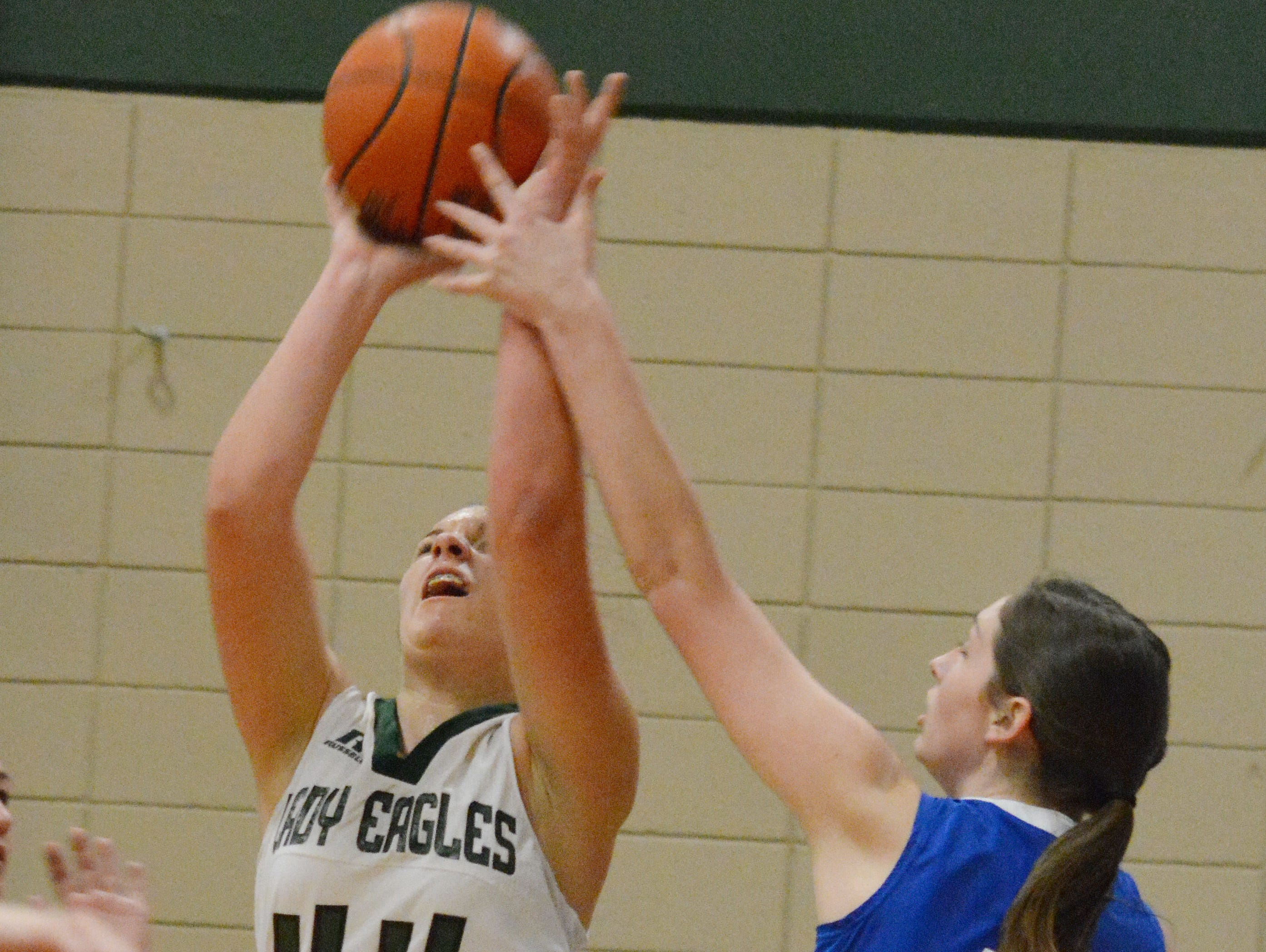 Menard's Emily Feazell (44, left) attempts to shoot during the Lady Eagles' loss to Lake Arthur in the LHSAA girls basketball playoffs Tuesday, Feb. 24, 2015.