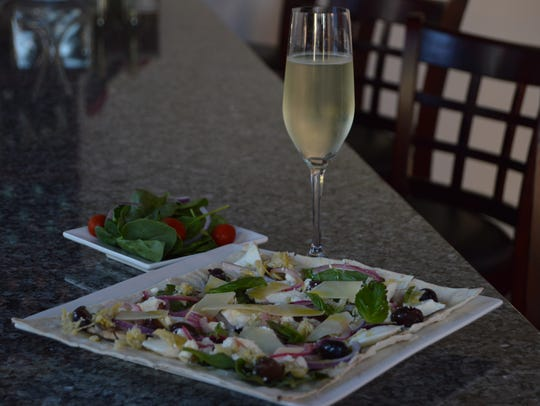 The Mediterranean flatbread is pictured here served