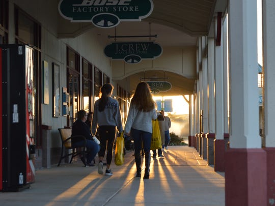 Shoppers searching for Black Friday deals are up with the sun at the Rehoboth Beach Tangier Outlets on Friday Nov. 27, 2015.