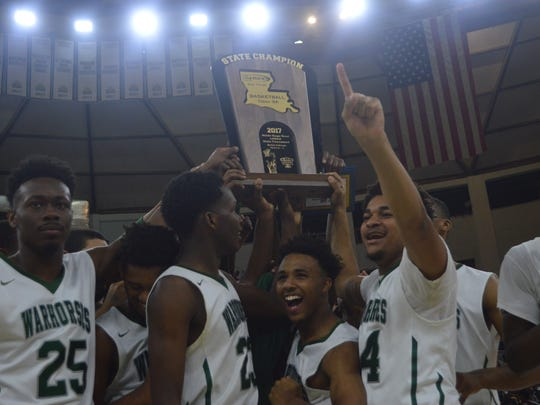 The 2017 Peabody boys basketball hoist the Class 3A title after defeating Wossman.